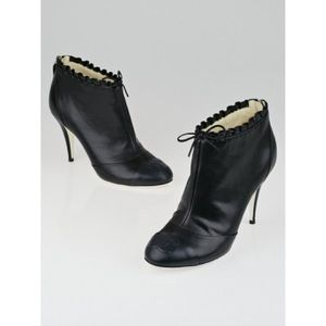 CHANEL Black Leather Ruffle & Cap-Toe Ankle Boots
